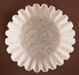 Uses for Coffee Filters, Coffee filter on a brown background.