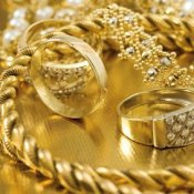 A shiny pile of gold chains, rings and other jewelry
