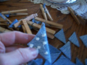Dots of glue on triangle of denim