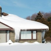 Preparing for Snow Emergencies. A house after a winter snow storm.