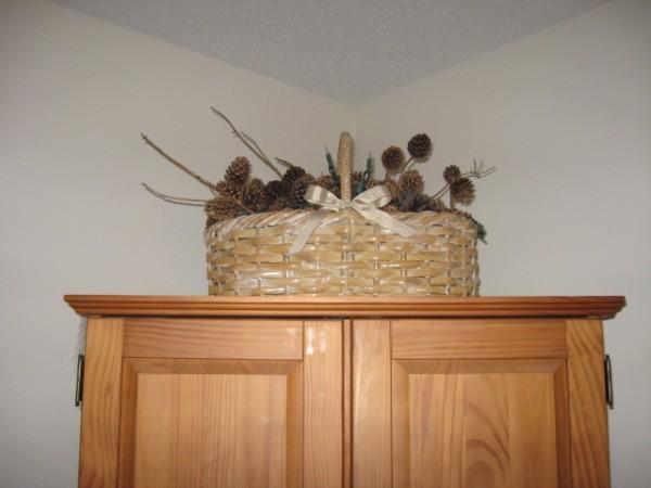 Holiday basket on cabinet