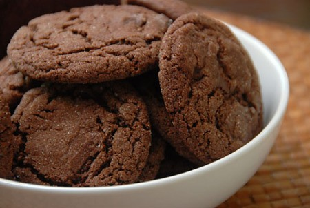 A bowl of chocolate and berry cookies.