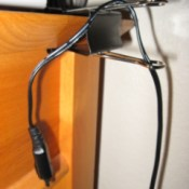 Black Paper Clip attached to edge of desk for cord