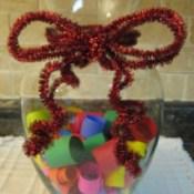 Memory jar with decorative ribbon.