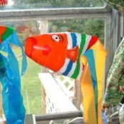 Pop bottle fish with colorful streamers for its tail.