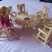 Barbie doll with clothes pin furniture.
