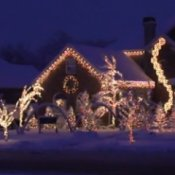 Best Christmas Light Shows. House decorated in white Christmas lights