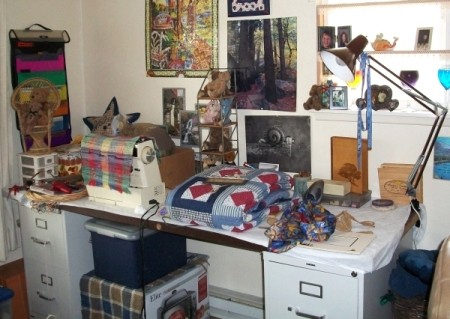 "Craft ""table"" after reorganizing - table is door held up by two file cabinets and holds sewing machine and craft items"