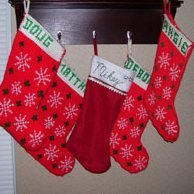 A group of Christmas stockings hanging on a shelf.
