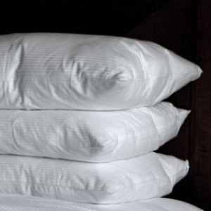 A stack of soft fluffy down pillows.
