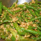 Green beans cooked with chopped pinenuts and spices.