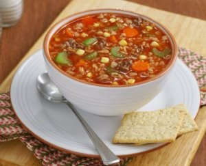 A bowl filled with vegetable beef soup.