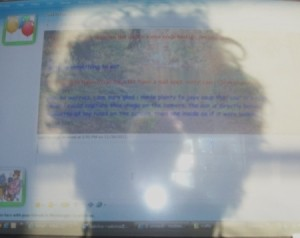 Odd Silhouette Reflected on Computer Screen