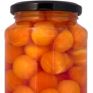 Jar of canned papaya balls in syrup.