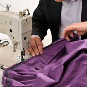 Sewing a woman's skirt.