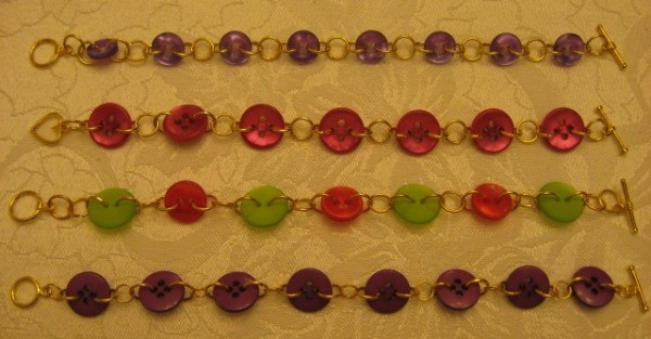 Four finished bracelets of varying colors.