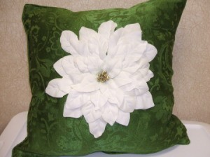 White Poinsettia on Green Pillow