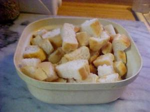 A dish of cut up bread cubes for stuffing.