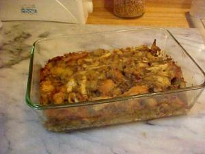 A casserole dish of sage bread stuffing for or to serve with poultry