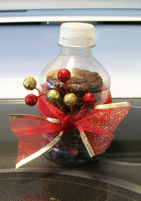 Cookies stacked in 8 oz. water bottle with ribbon and decorations tied around the center.