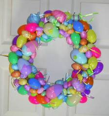 Photo of an easter egg wreath made with plastic eggs.