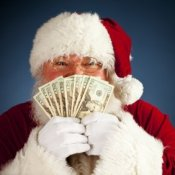 Budgeting for Christmas, Santa Peeking over Cash