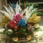 Recycled decorations arranged in bowl.