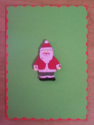 Glue the Christmas ornament to the front of the card.