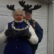 Husband and wife with reindeer antlers and bells