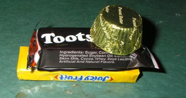 Reese's mini cup on top of Tootsie.