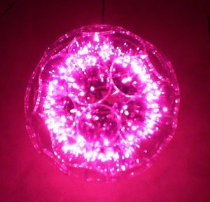 photo of a pink sparkle ball christmas decoration