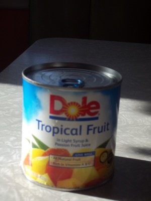 Pull top can of Dole tropical fruit.