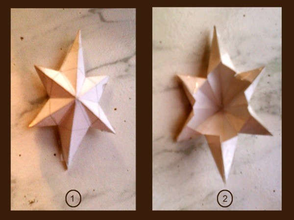 Front and back view of plain paper folded star.