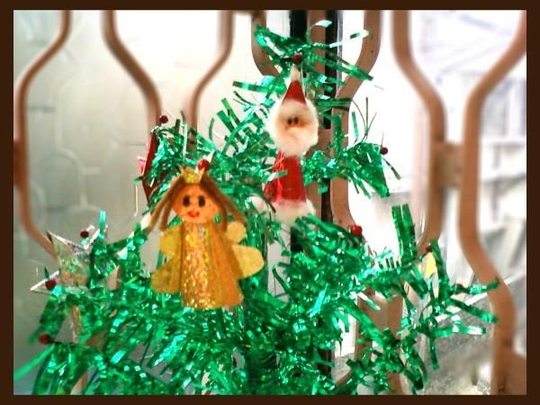 Santa and Angel Ornament on Tree