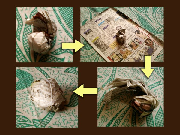 Making newspaper ball.