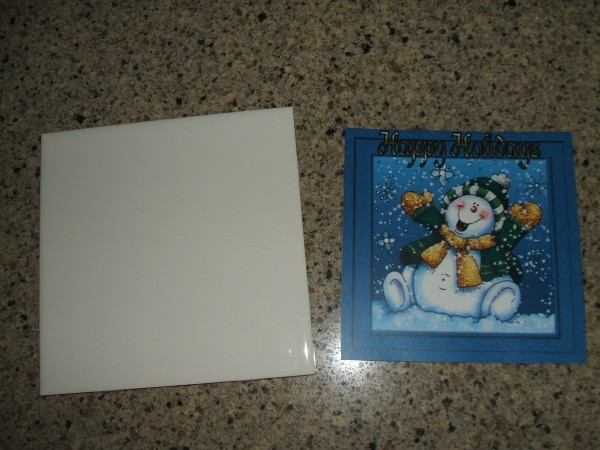 White tile and Christmas card front.