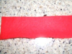 2 inch wide length of red felt.