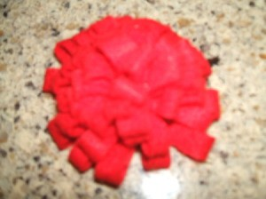 Finished rolled felt flower.