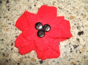 Three buttons added to center of flat flower.