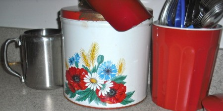 Retro canisters with flower decal.