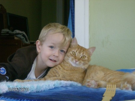 Young boy with Tigger the cat.
