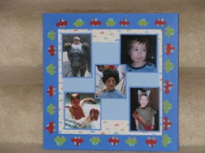 framed child's photos on scrapbook paper.