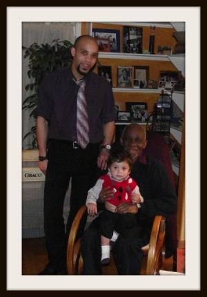 Three Generations of Moses Posing in Family Room