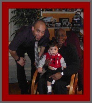 Three Generations of Moses With Grandpa in Rocking Chair