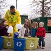 Recycling Tips, Man Helping Children Sort Recycling