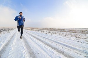Working Out In the Winter, Man Jogging on Snowy Road