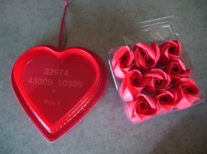 Bottom of heart shaped candy box and rose shaped soap.