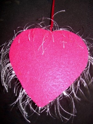 Felt applied to back side of heart box.