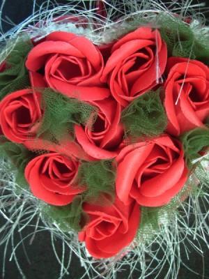 Closeup of rose soap filled box.