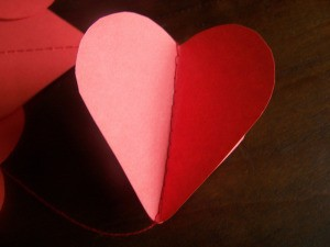 Hearts folded slightly open for 3-D effect.